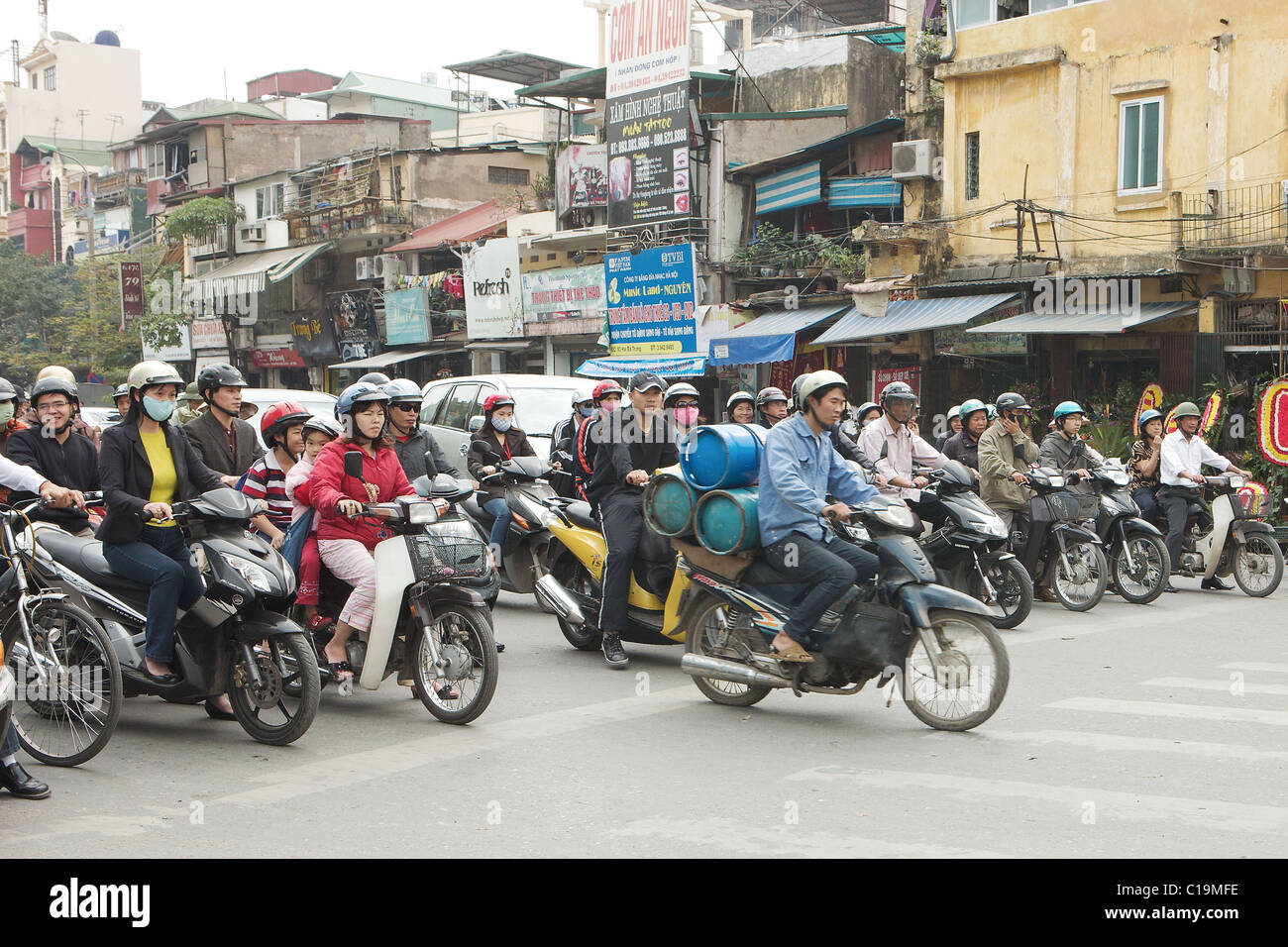 Two-wheeled transport clogs the streets of Hanoi, Vietnam - Stock Image