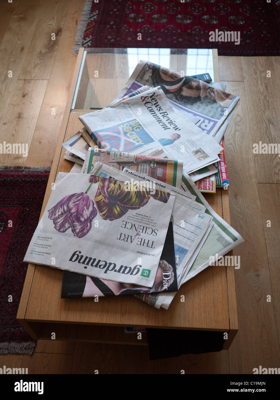 newspapers scattered on a coffee table stock photo: 35249165 - alamy