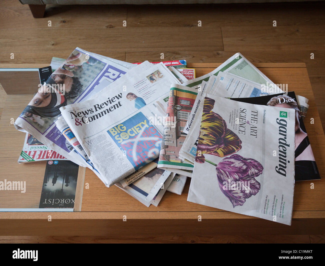newspapers scattered on a coffee table stock photo: 35249196 - alamy