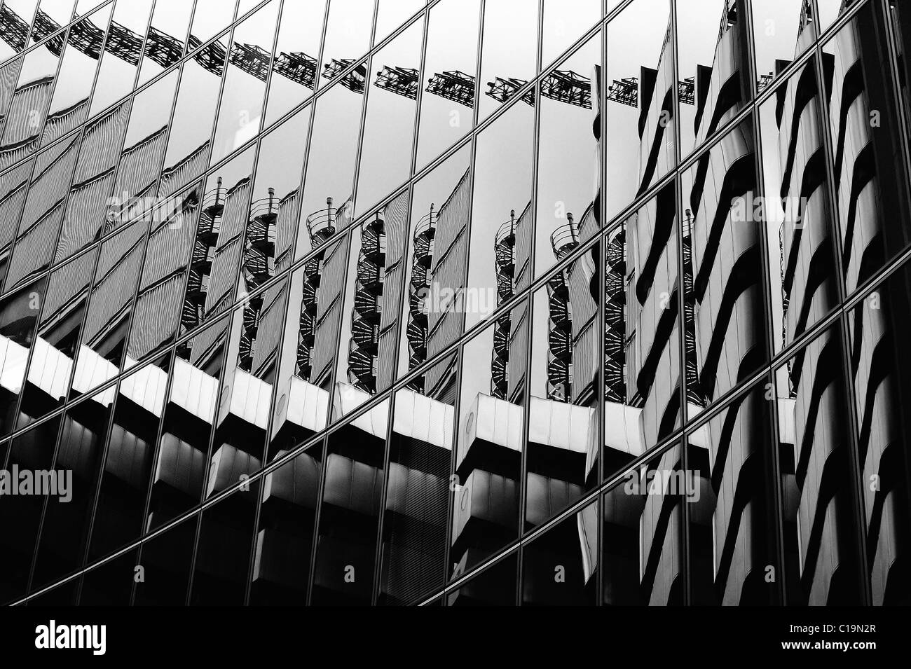 The Lloyds Building reflected in the Willis Building across the road. - Stock Image