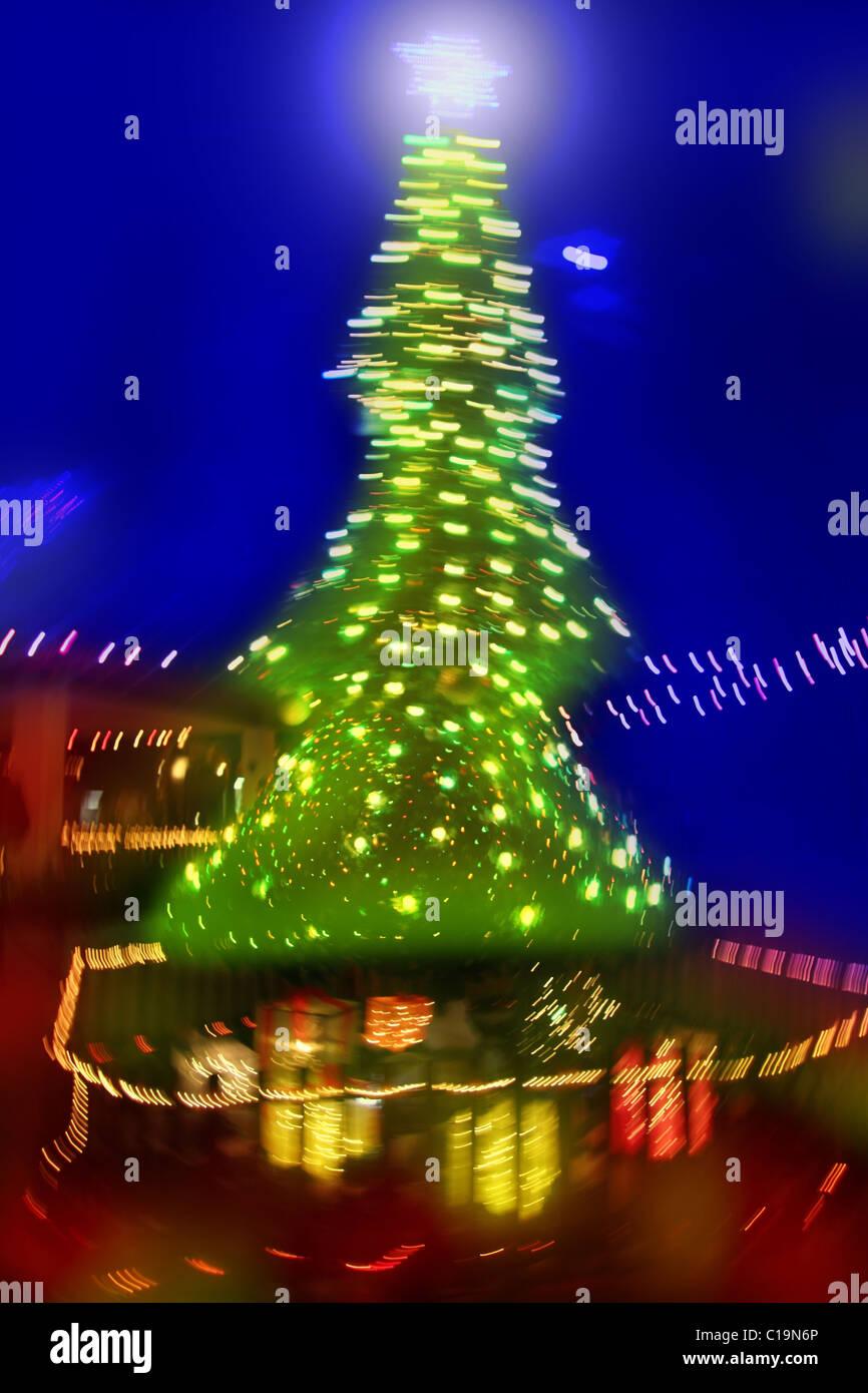 abstract christmas tree night blurred lighting - Stock Image