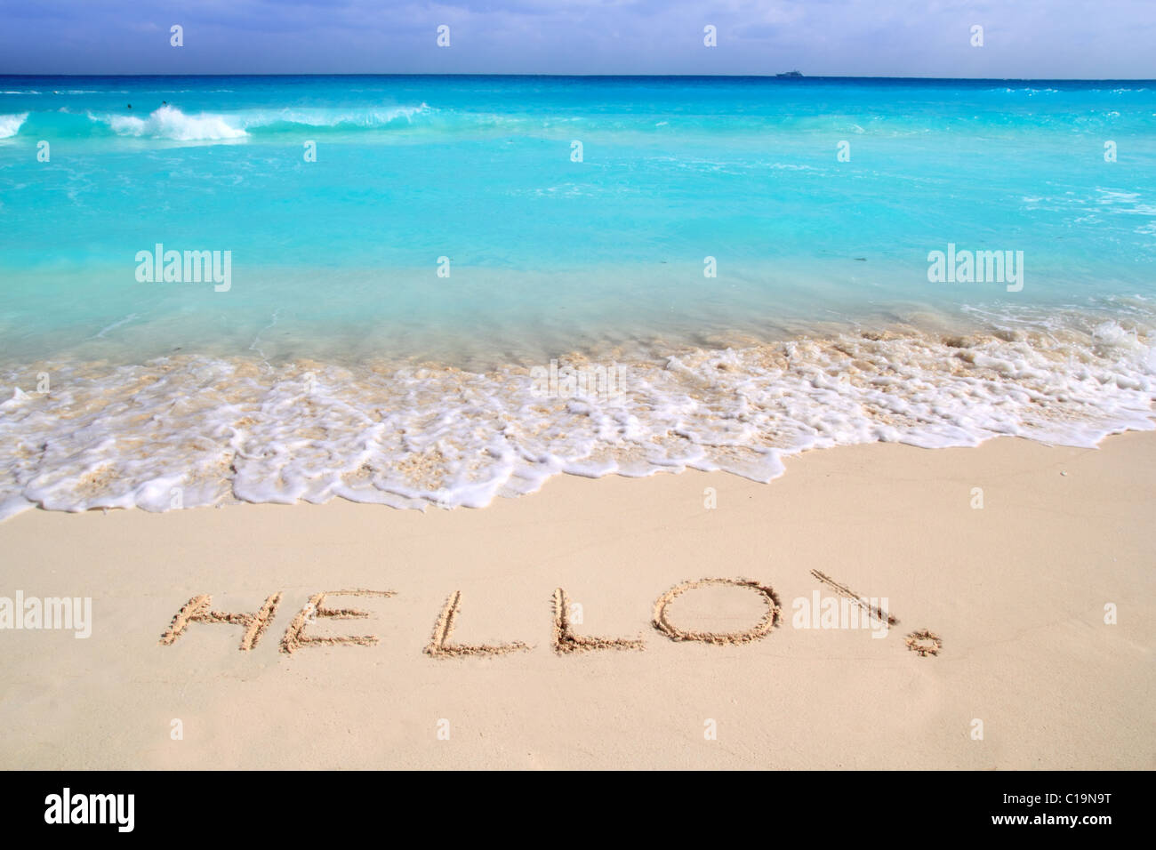 Hello message spell written in tropical beach sand Caribbean turquoise sea - Stock Image