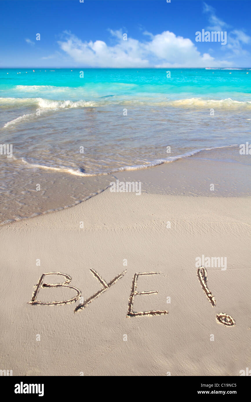 Bye spell written in beach sand tropical Caribbean end of vacation - Stock Image