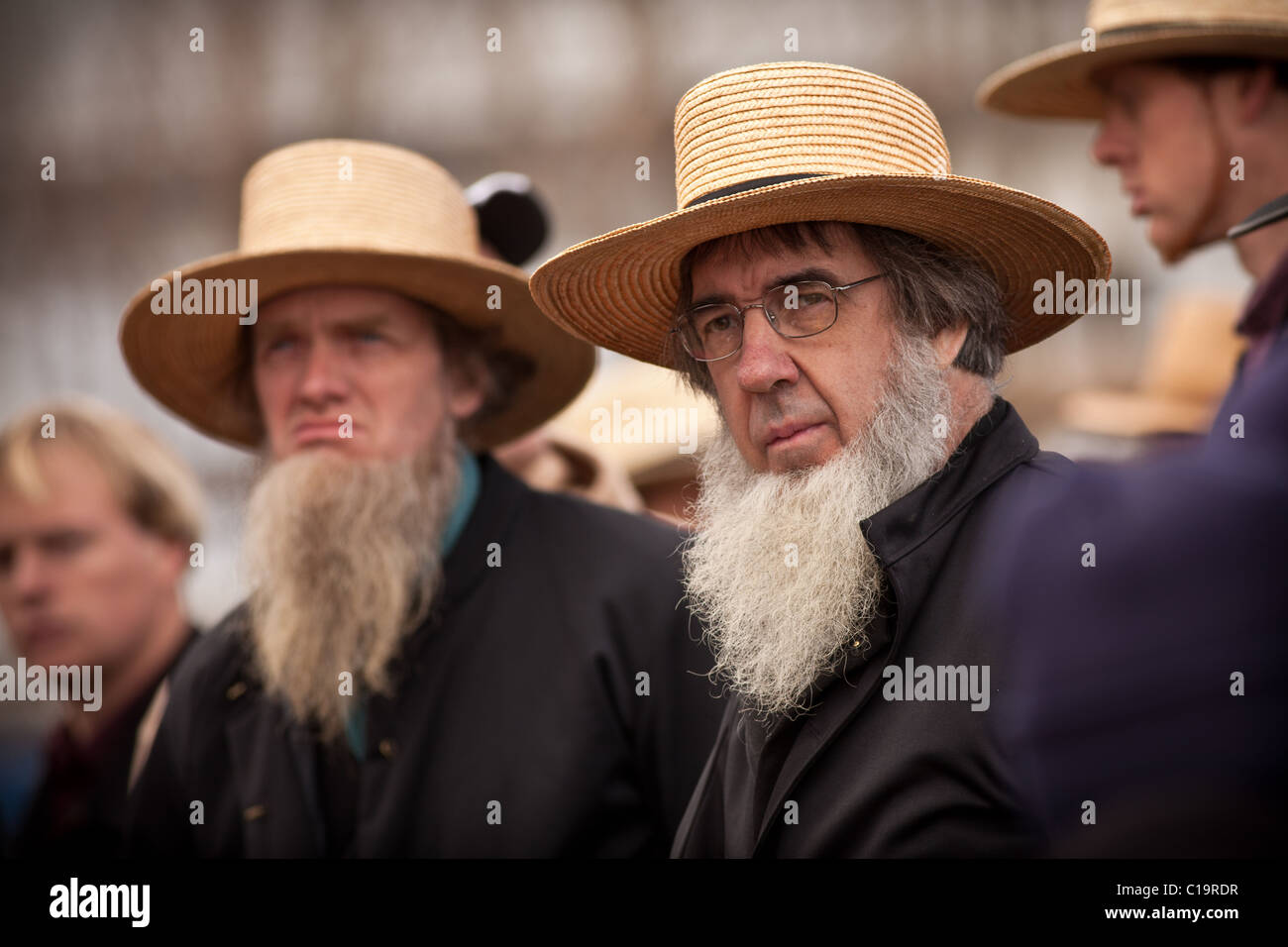 Amish men watch the horse auction during the Annual Mud Sale to support the Fire Department Stock Photo