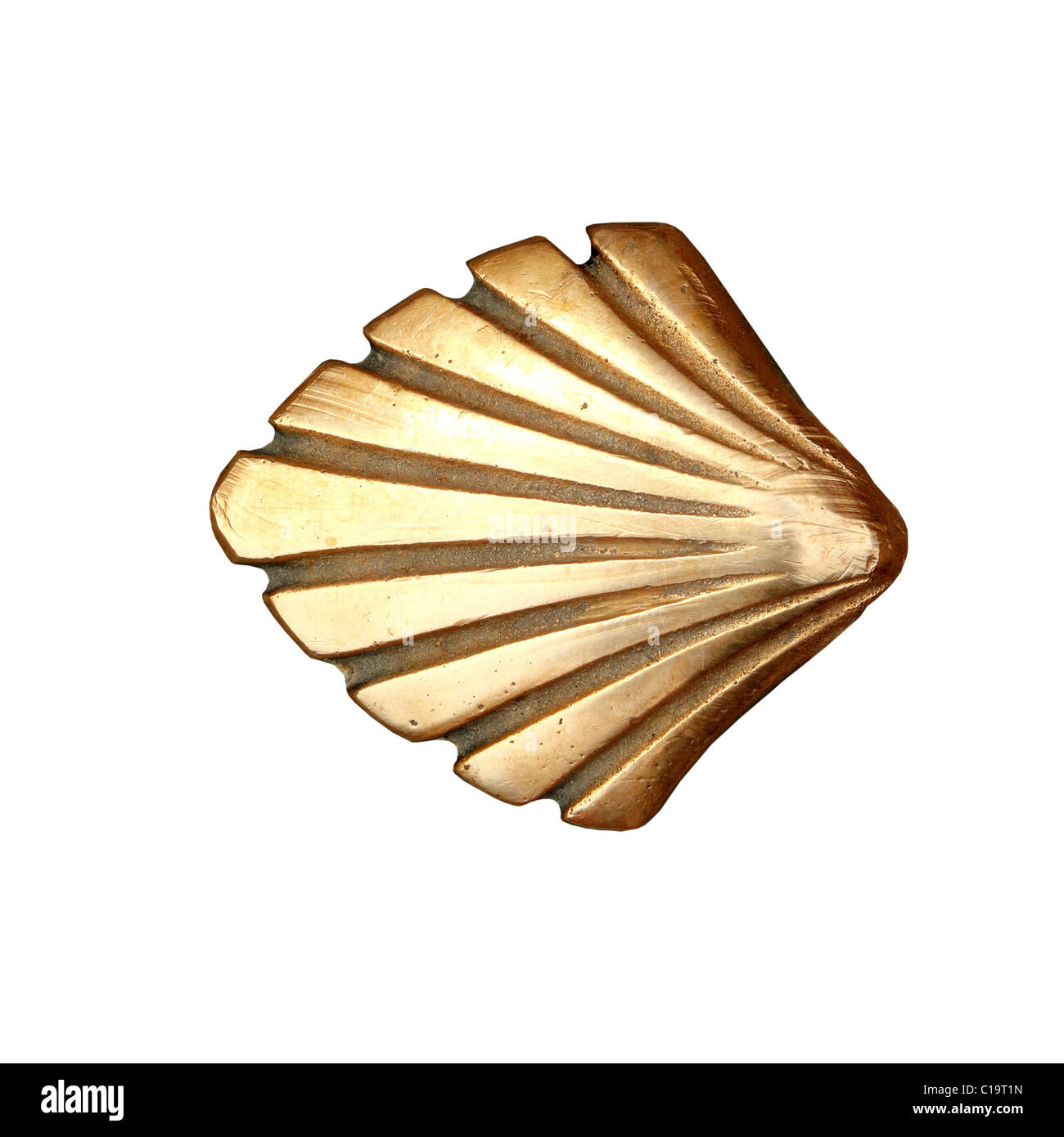 Saint James way shell golden metal on streets soil isolated on white - Stock Image
