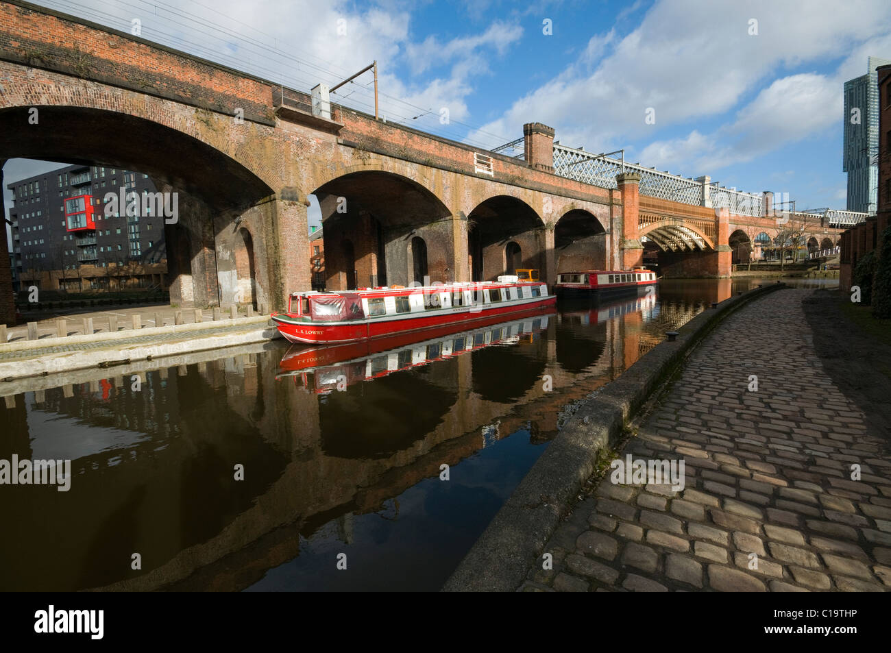 Victorian railway viaducts , bridges and canal barges in the Castlefield basin Manchester Stock Photo