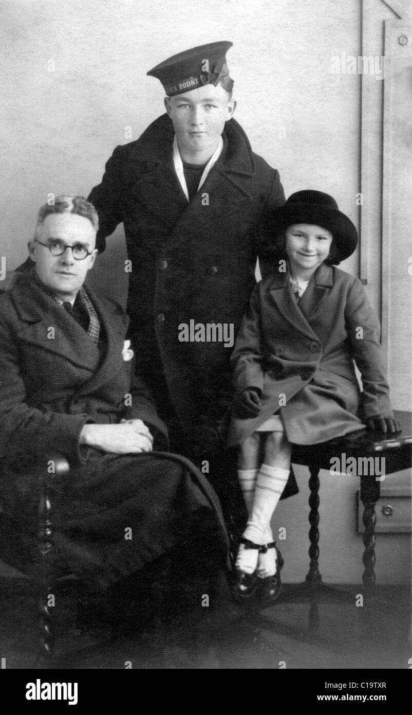 Young sailor boy home on leave from HMS Ganges with his father and young sister 1934 - Stock Image