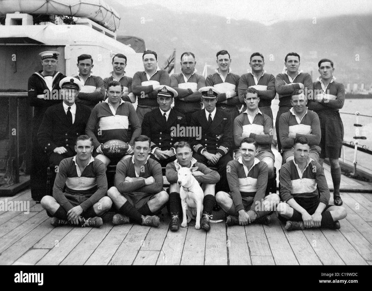 Royal Navy group photo rugby team on deck HMS Adventure 1936-37 thought to be in Hong Kong - Stock Image