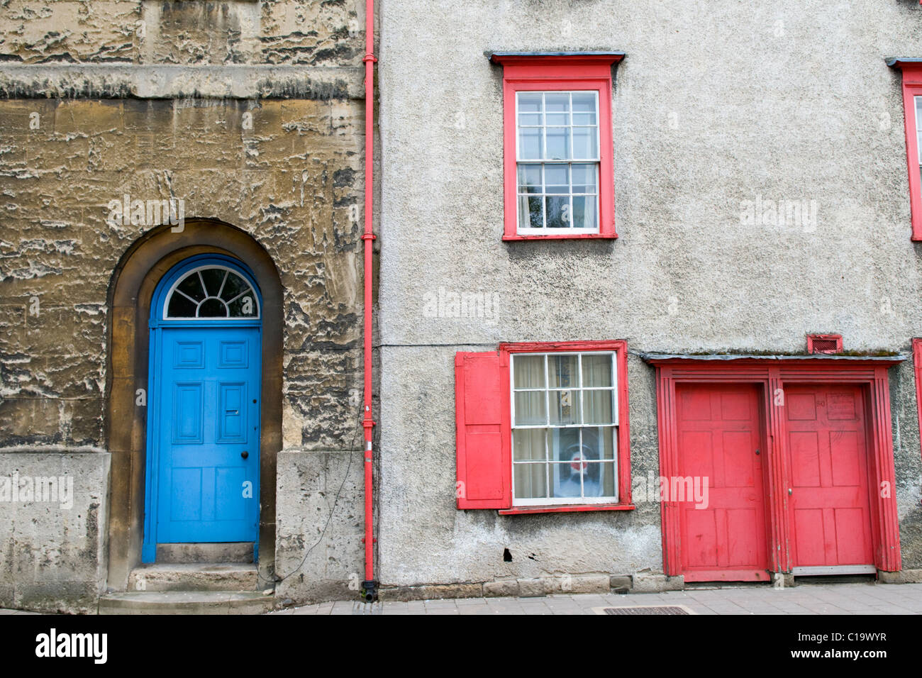 Red And Blue Painted Front Doors And Windows On Houses In Oxford
