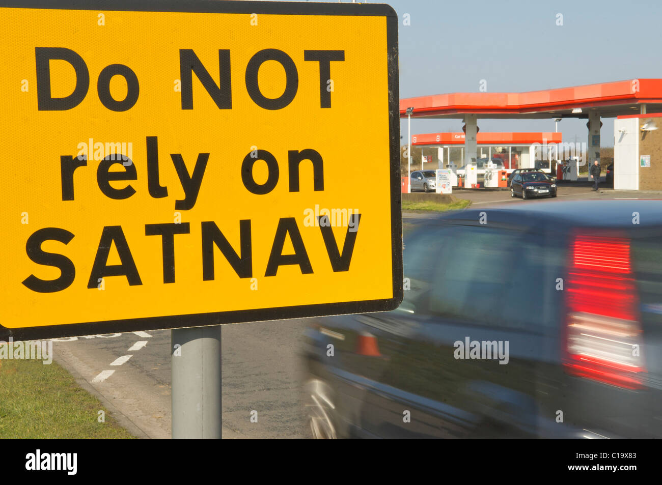 Do not rely on Satnav warning sign on busy road - Stock Image