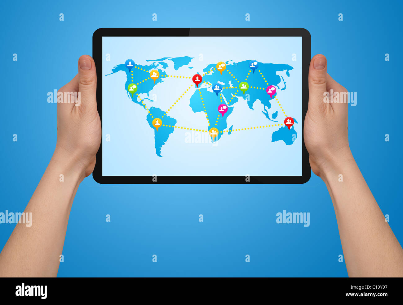 a male hand holding a modern touchpad with social map - Stock Image
