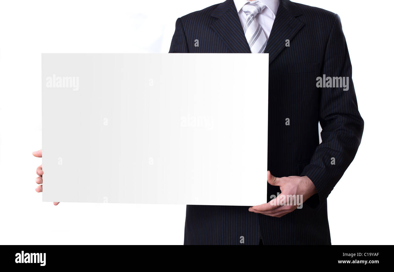 Businessman holding a blank white board - Stock Image