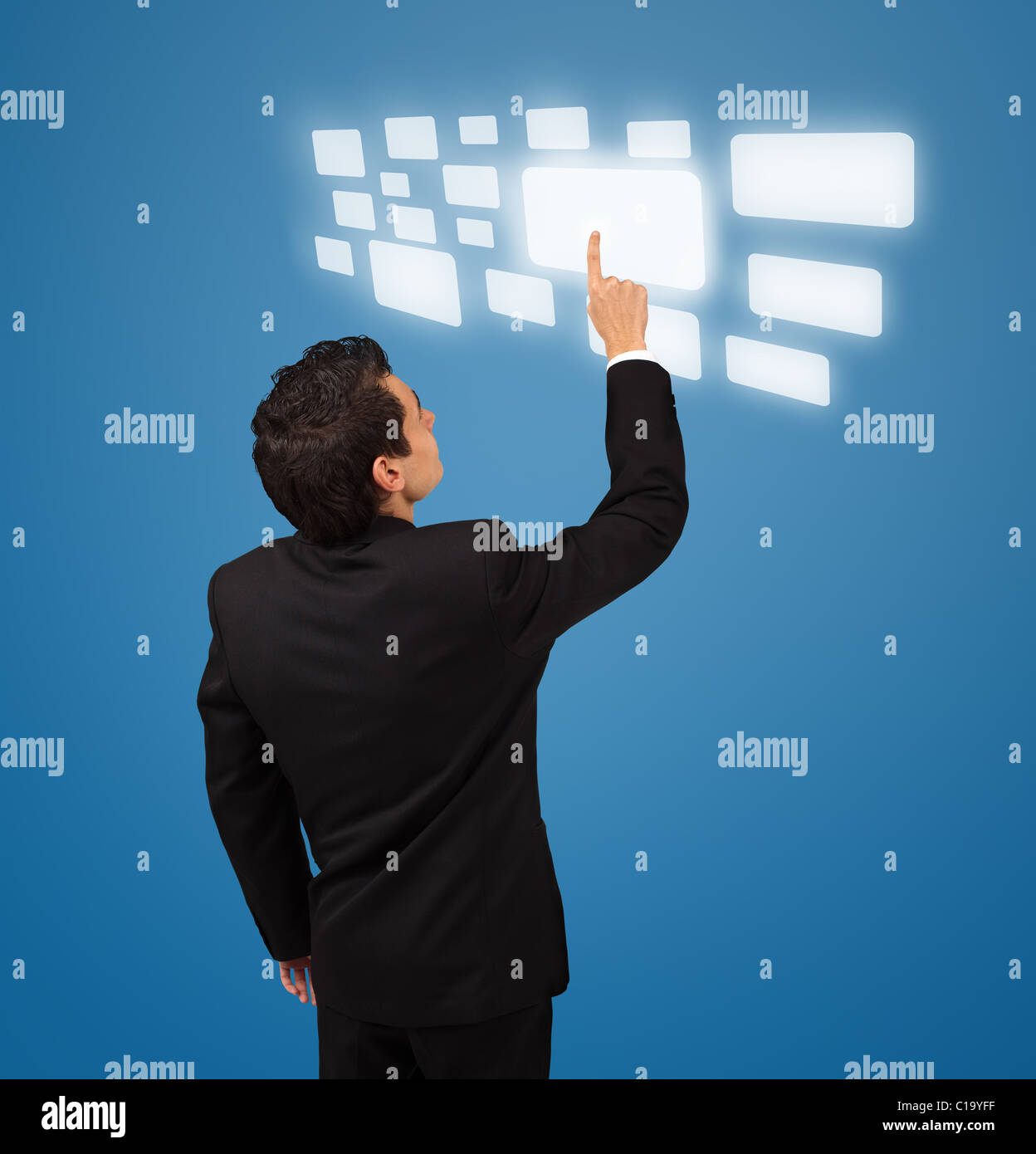 Business man pressing a touchscreen button - Stock Image