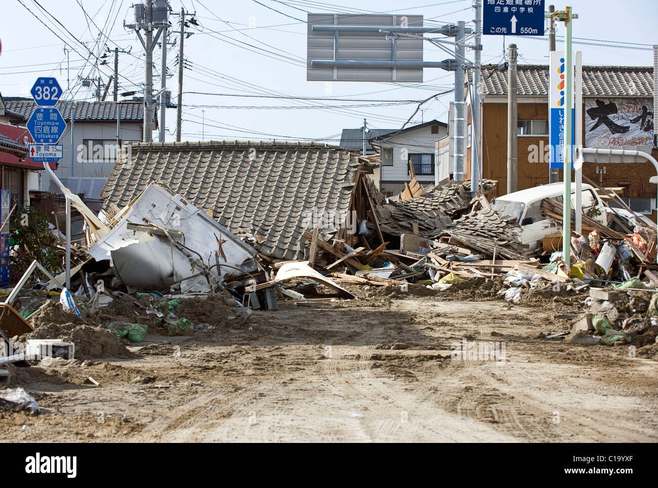 Photo shows a home and car swept inland by the tsunami that followed the March 11 magnitude 9 quake in Iwaki City, - Stock Image
