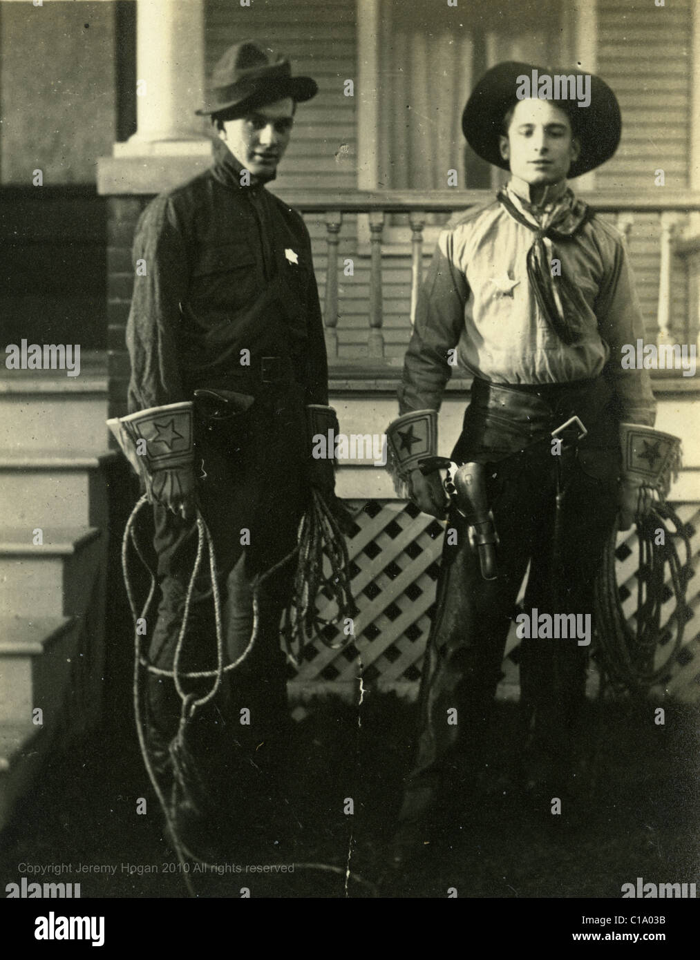 Cavalrymen dressed as cowboys with whips 1910s man veteran police sheriff - Stock Image