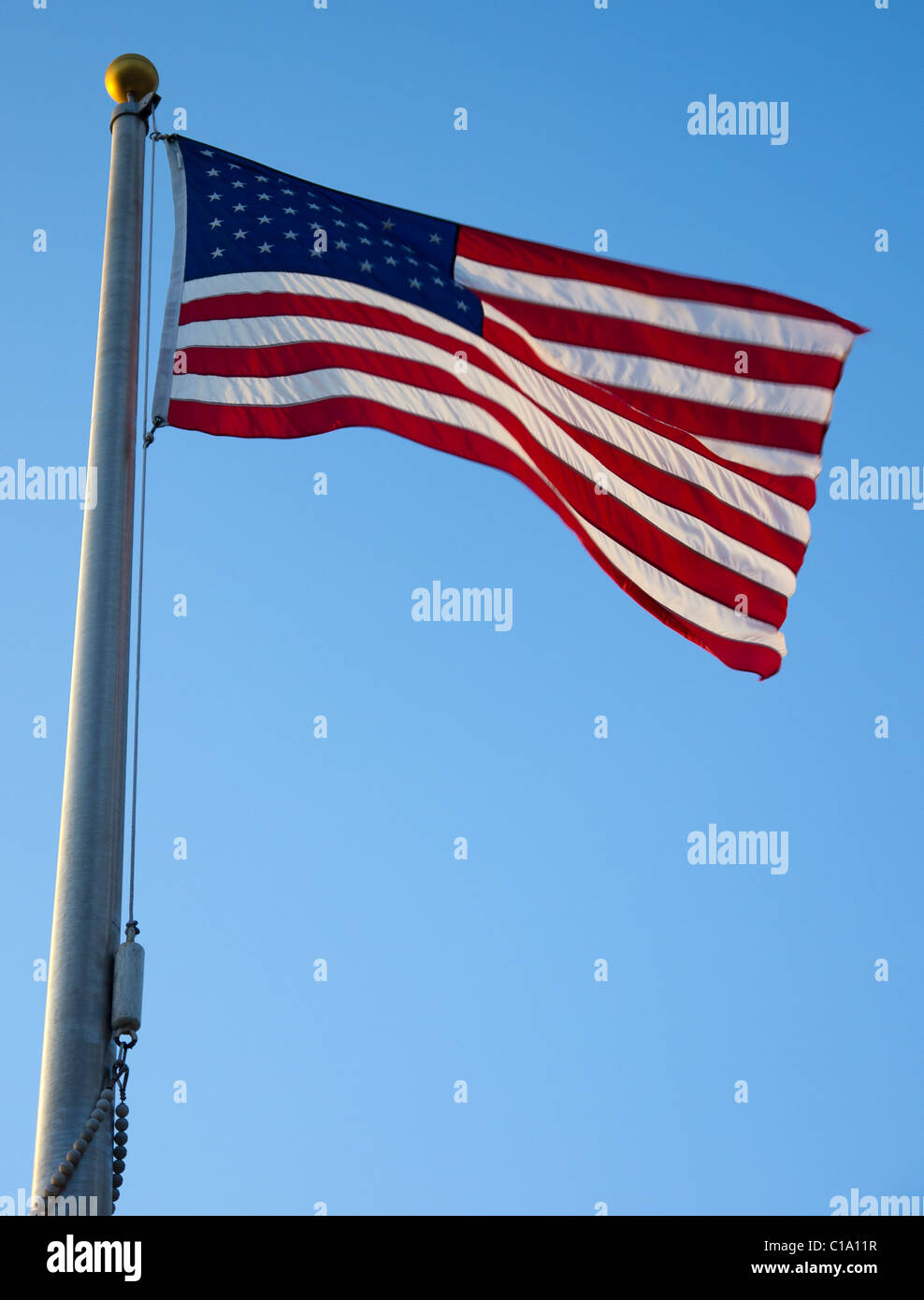 American flag waving in the wind viewed from below - Stock Image