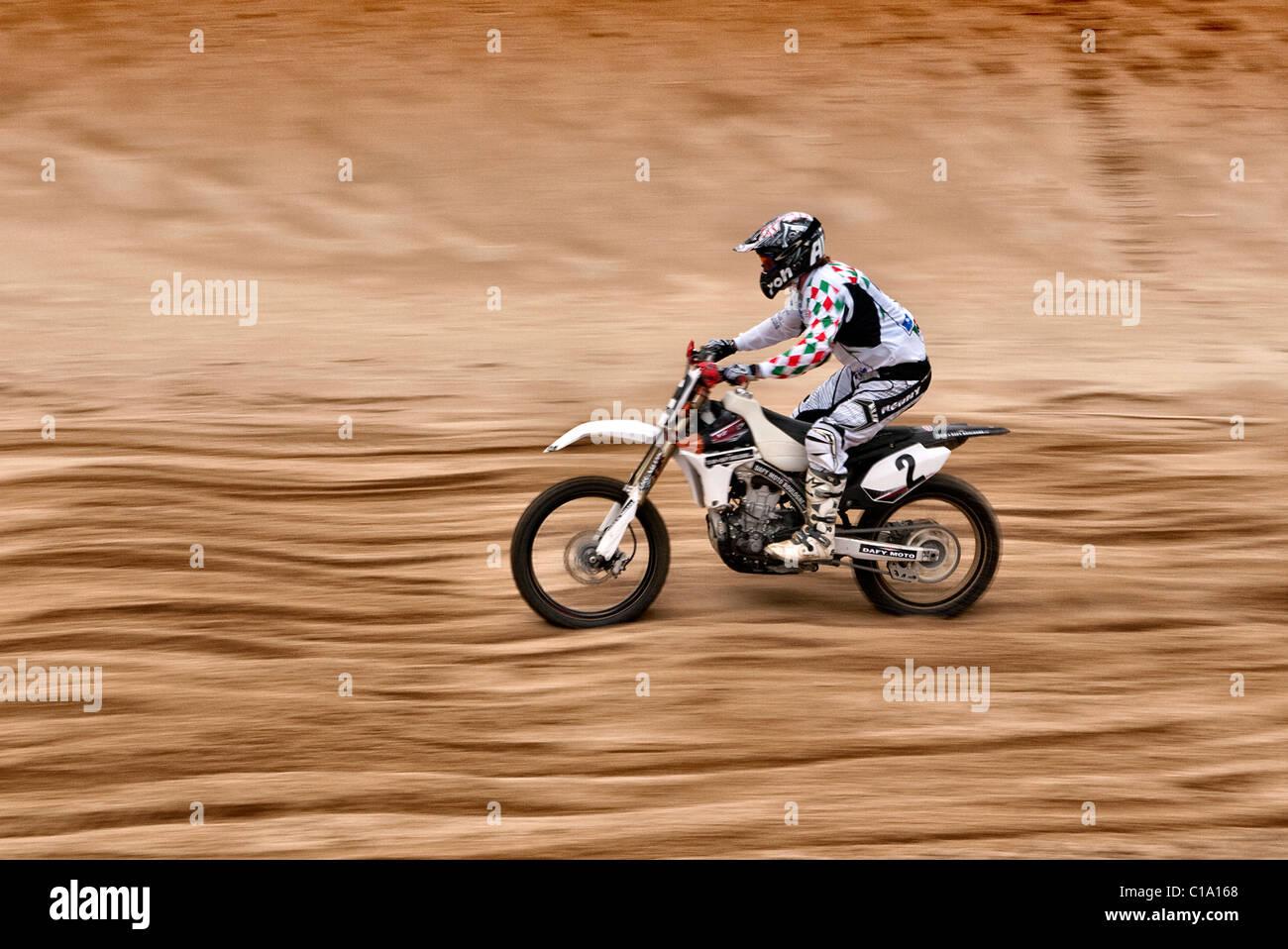 Moto Cross motorcycle rider at Margate Beach Cross meeting Thanet Kent UK - Stock Image