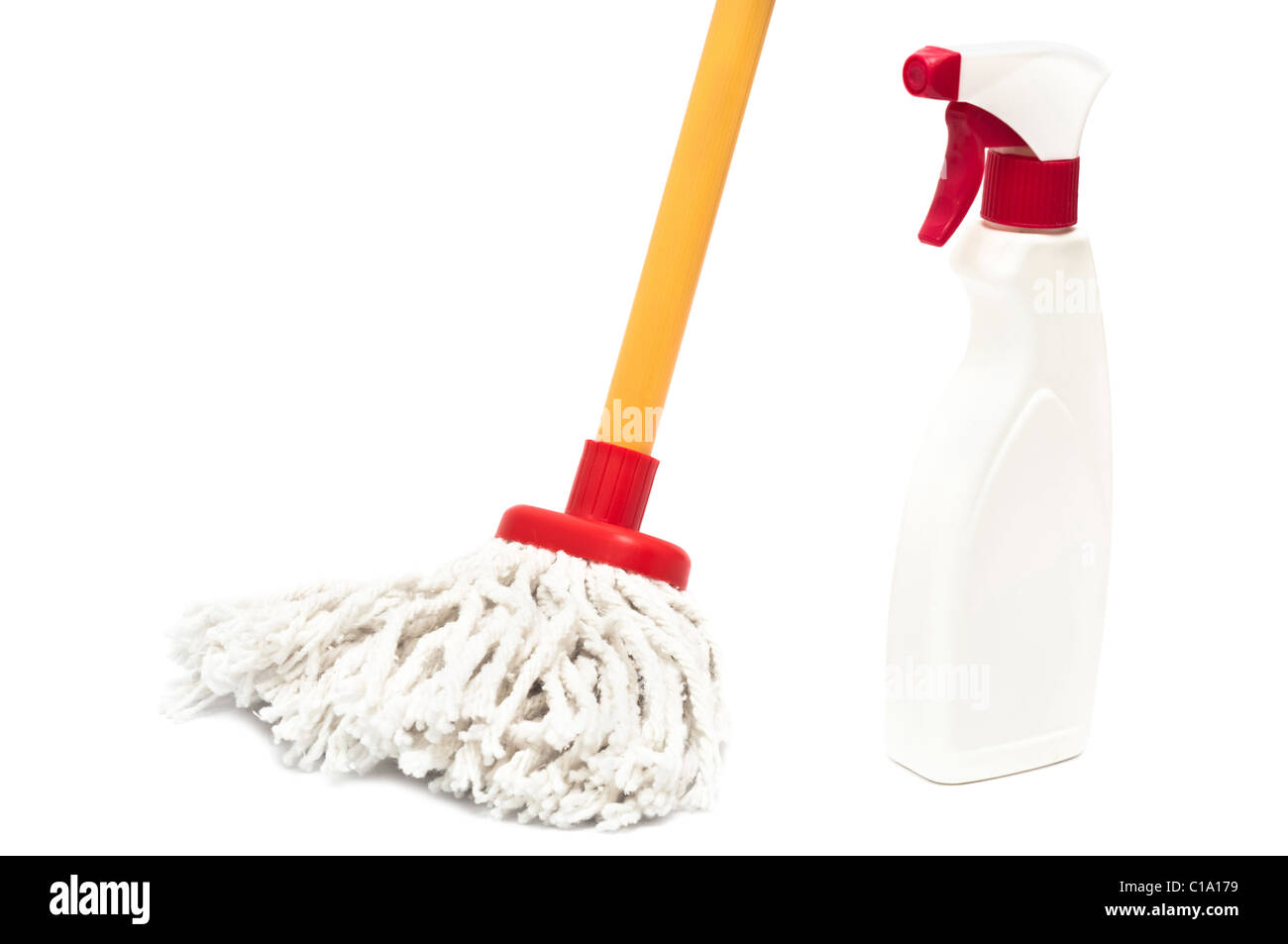 Close up of a mop and cleaner bottle isolated on white background - Stock Image