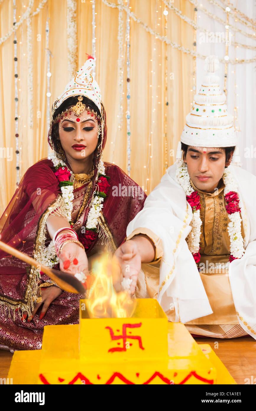 Couple Performing Yajna In Bengali Wedding
