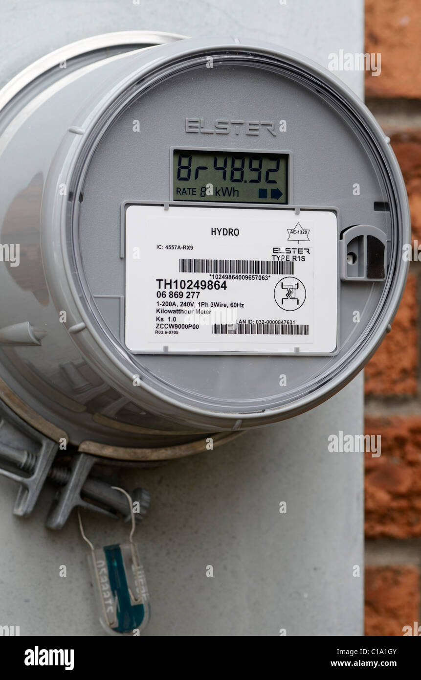 Hyrdro electrical Smart Meter retrofit outside a brick house - Stock Image