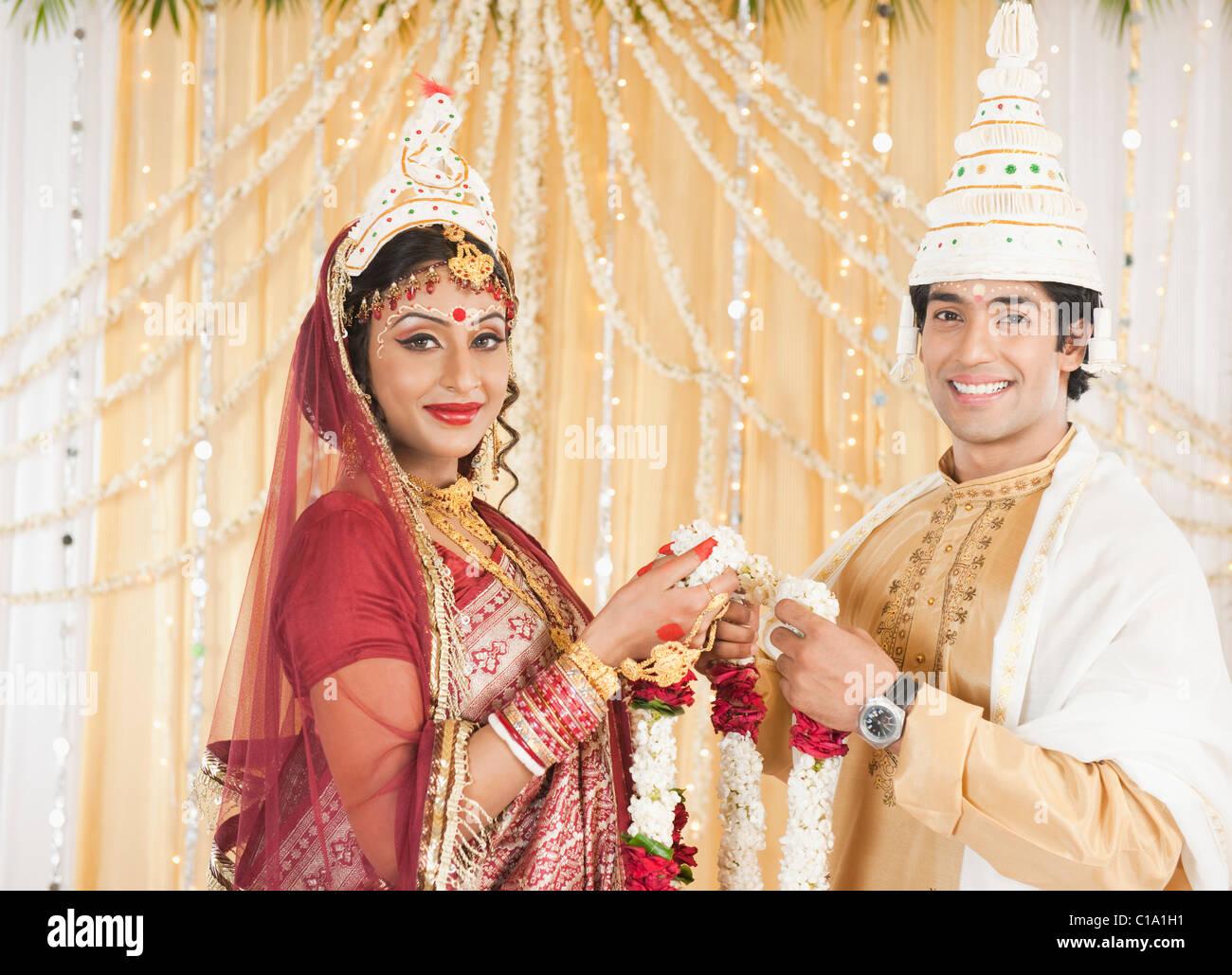 Couple Performing Mala Badal Garland Exchanging Ceremony In Bengali Stock Photo Alamy