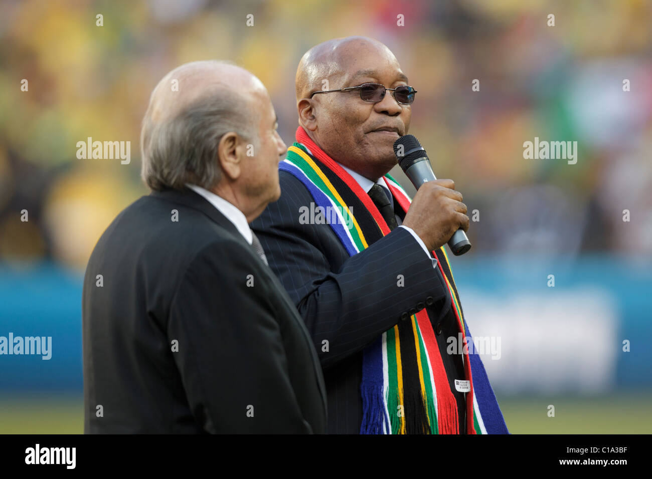 South African President Jacob Zuma (r) and FIFA President Sepp Blatter (l) deliver remarks at the opening of the - Stock Image