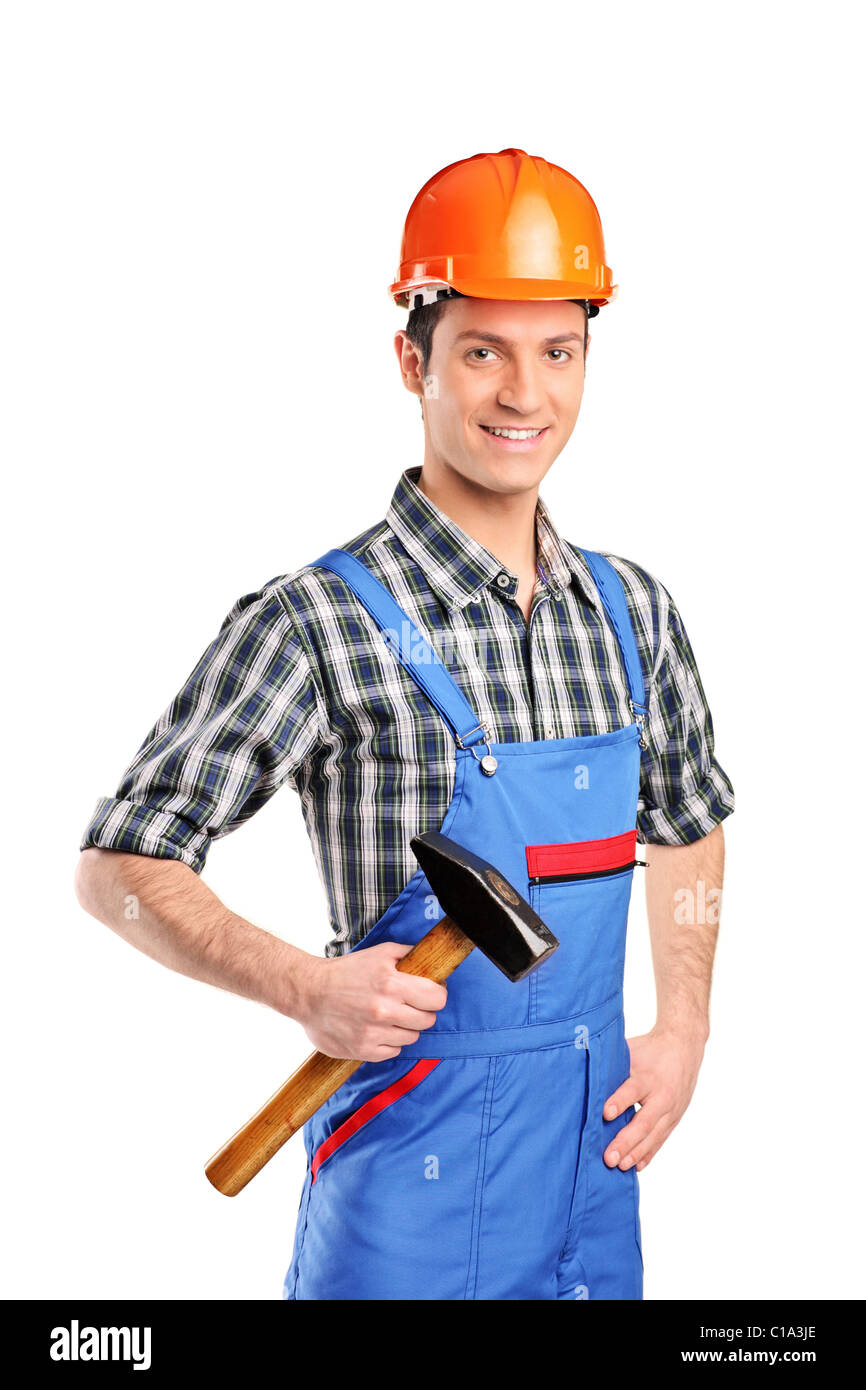 Manual worker wearing blue overall and holding a hammer - Stock Image