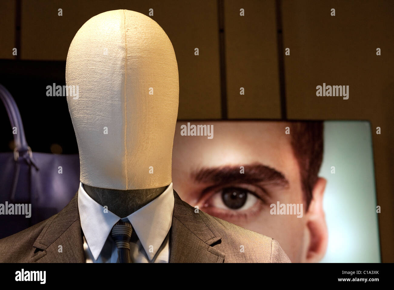 faceless shop window dummy and face peering over shoulder, Venice, Italy - Stock Image