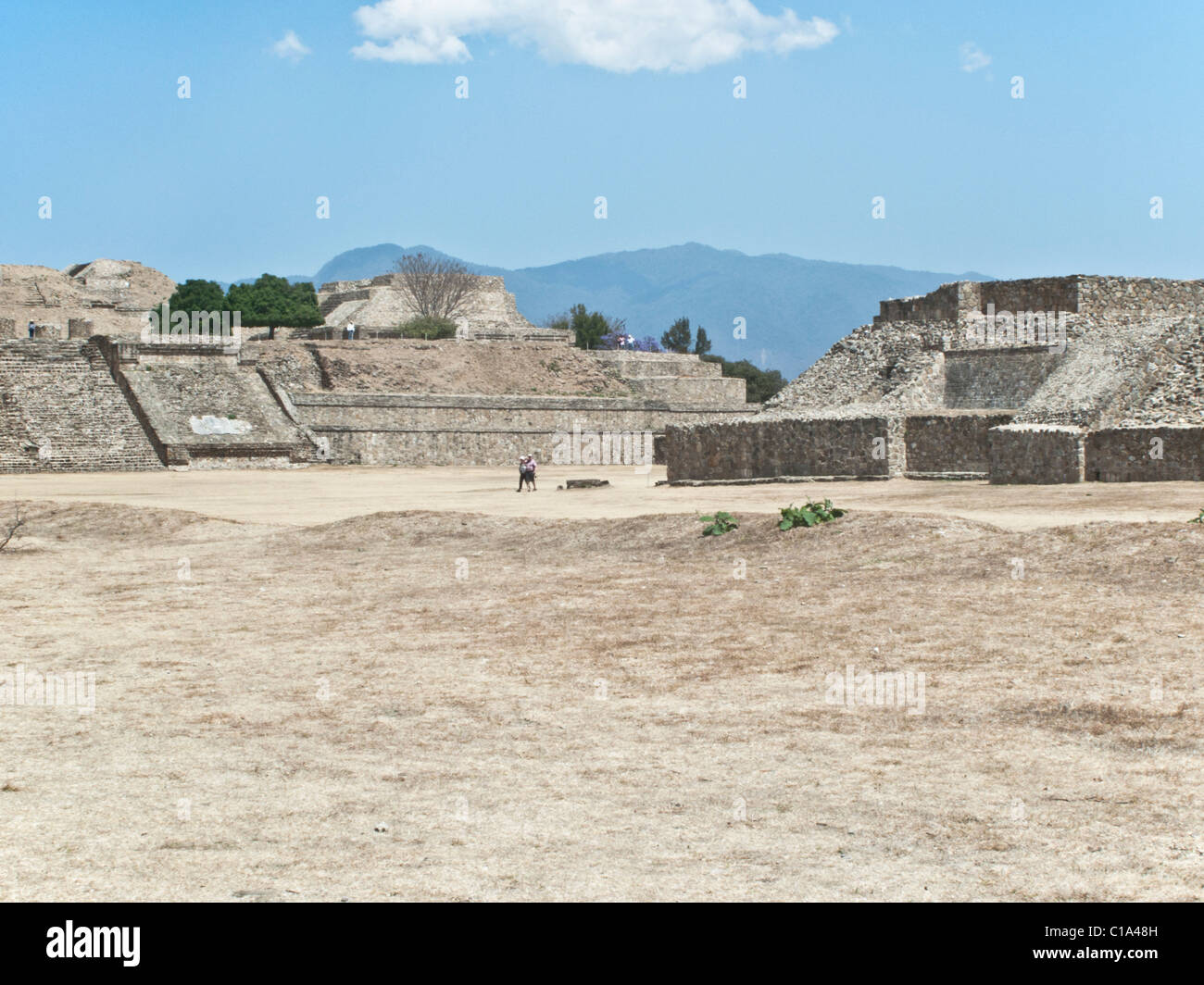 people wander across Great Central Plaza of regal pre Columbian archaeological ruins of ancient Zapotec city of - Stock Image