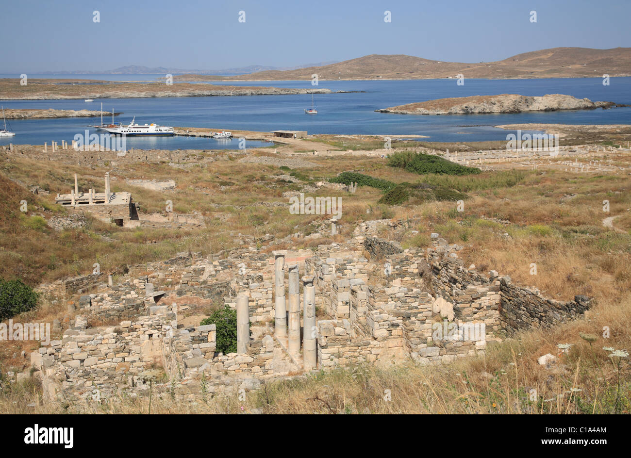 View of Sacred Harbour and Sanctuaries to the Foreign Gods from lower slops of Mt Kynthos, Delos, Cyclades Islands, - Stock Image