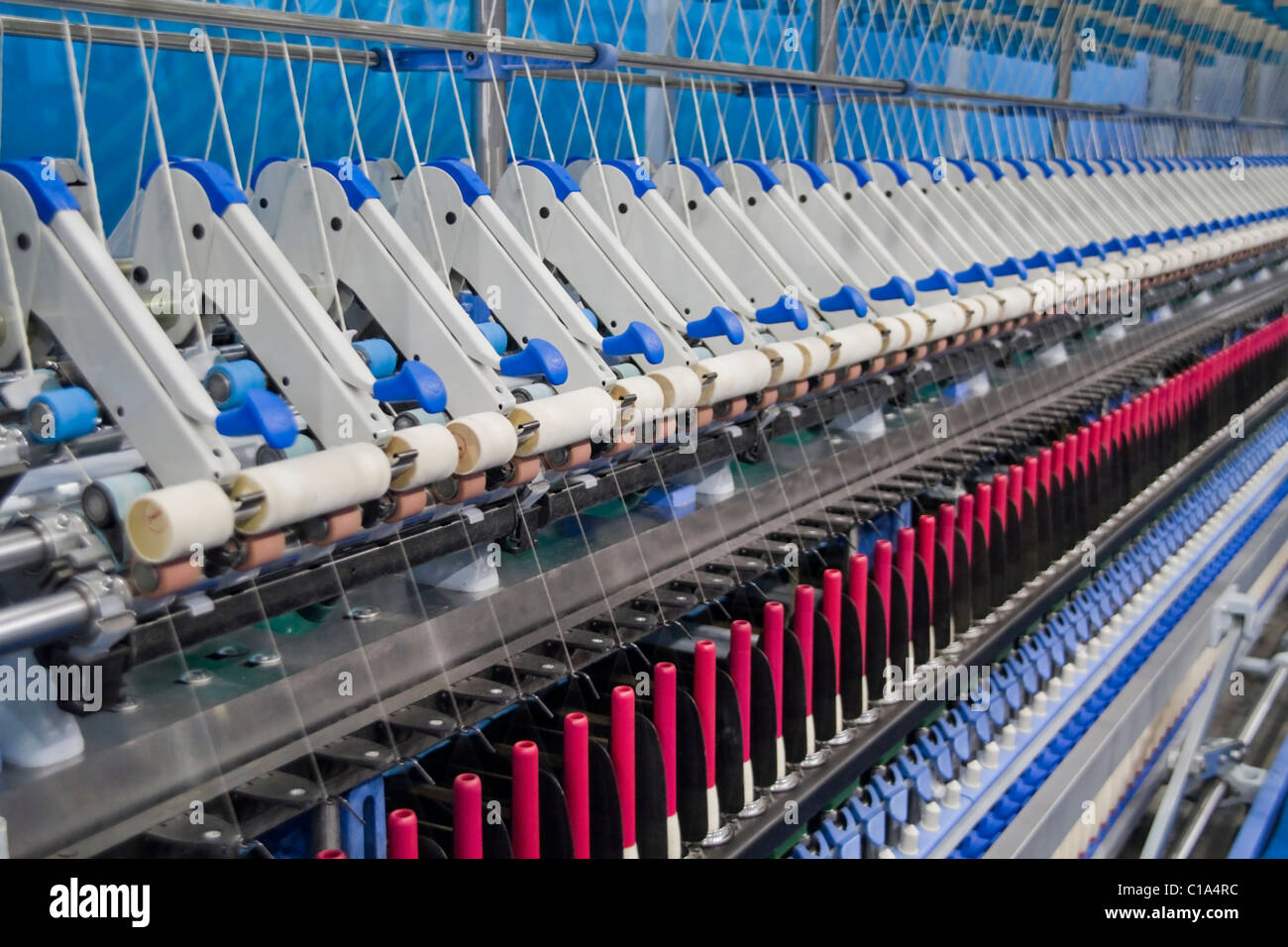 Cotton yarn production in a textile factory - Stock Image