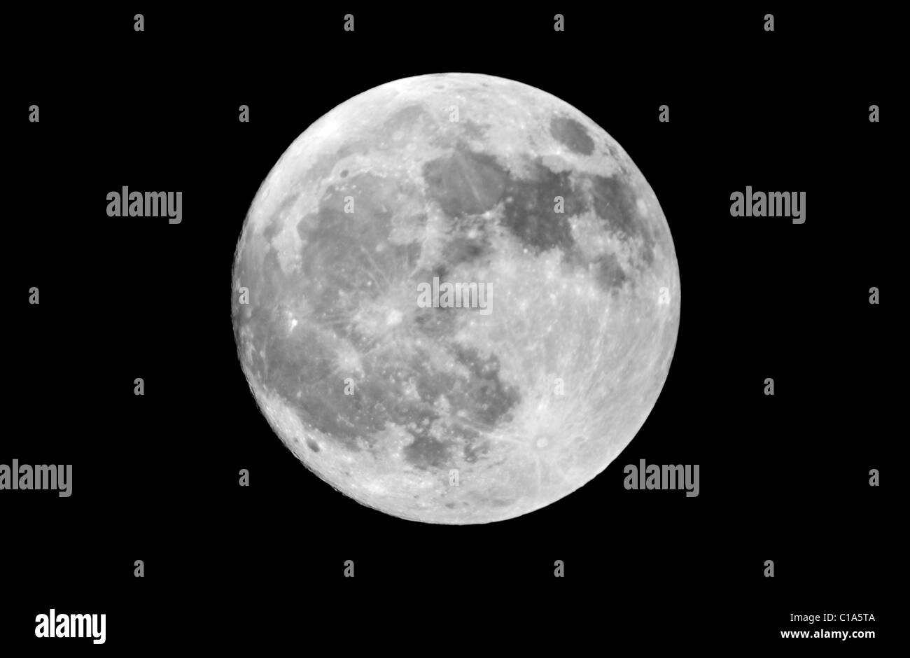 Actual photograph of the full moon taken at prime focus through an 8' Newtonian reflector telescope. Isolated - Stock Image