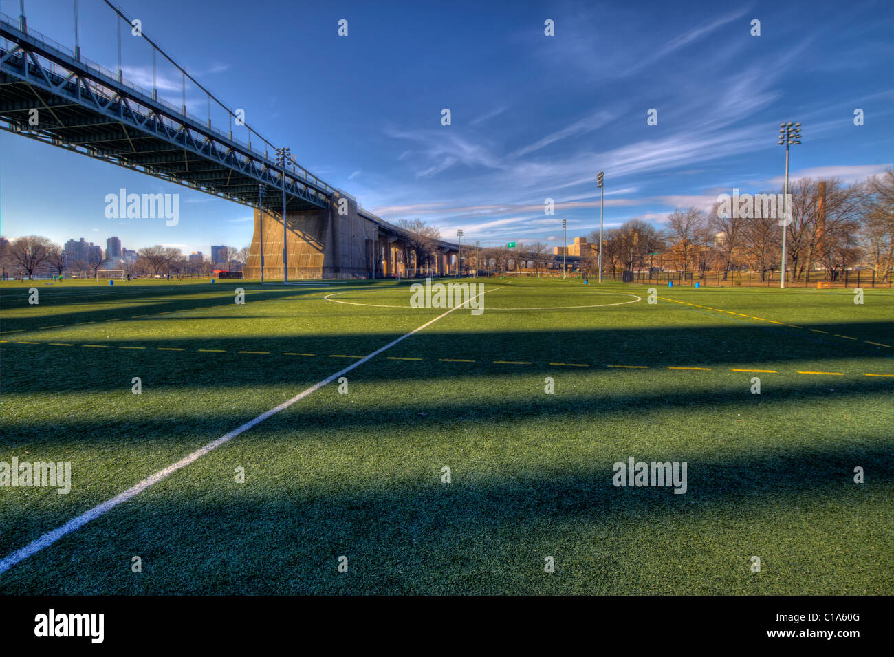 Soccer field under the RFK Bridge on Ward's Island in the East River in New York C ity - Stock Image