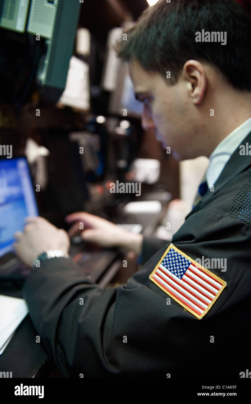 A Trader consults a laptop at one of the Trading Post. Stock Photo