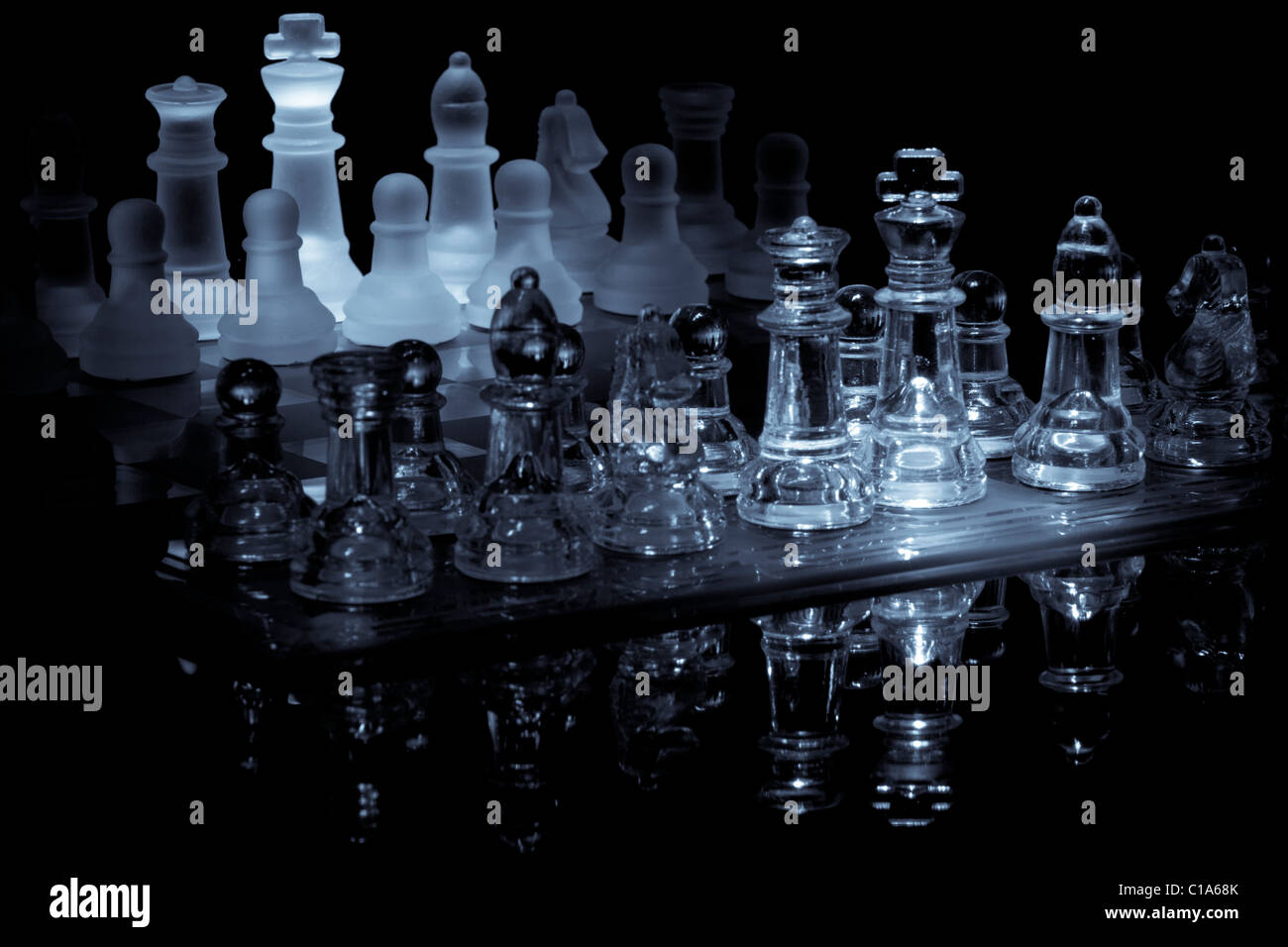 Glass Chessboard setup and awaiting move Stock Photo