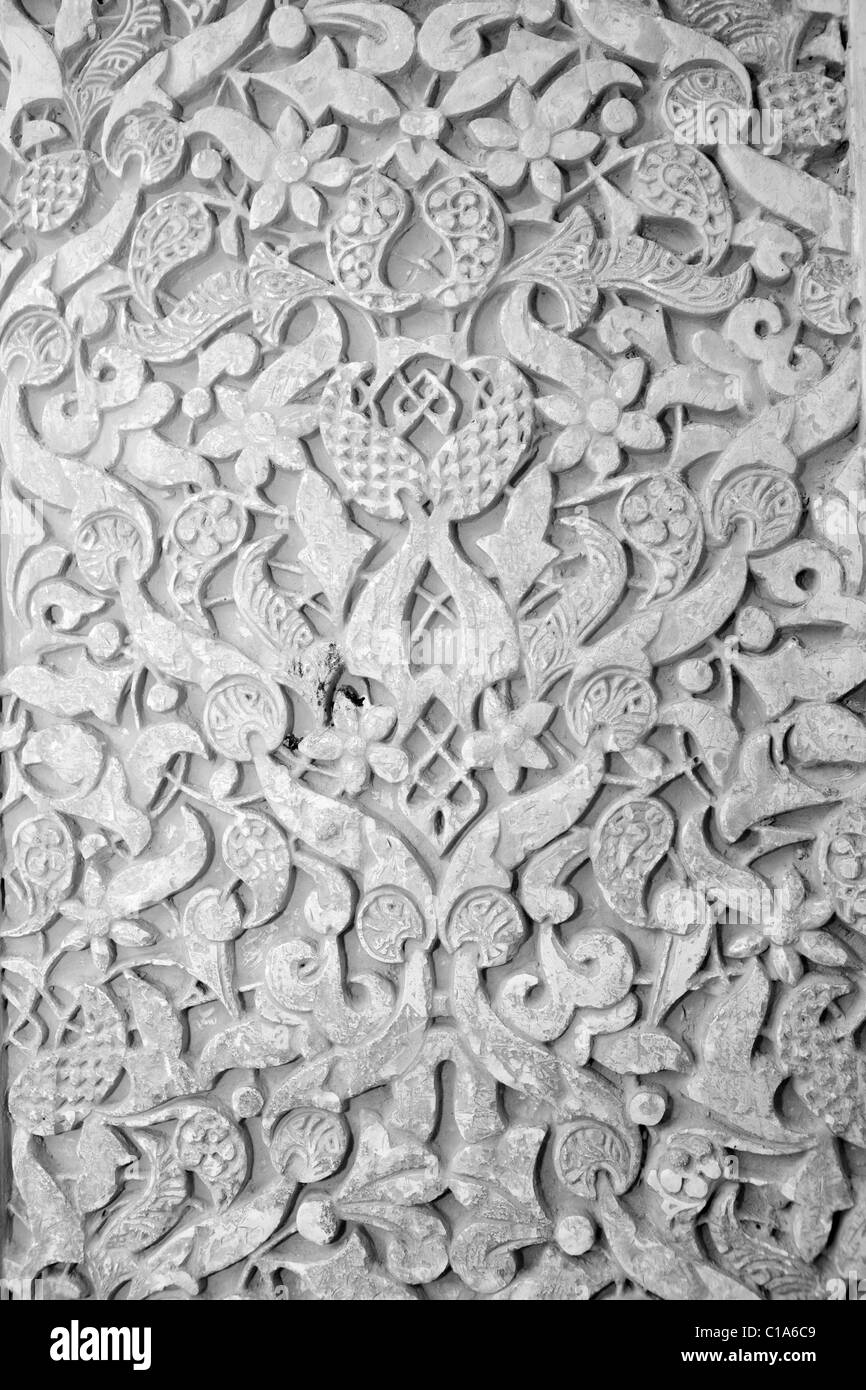 Textured carvings arabic themes in the alhambra granada spain