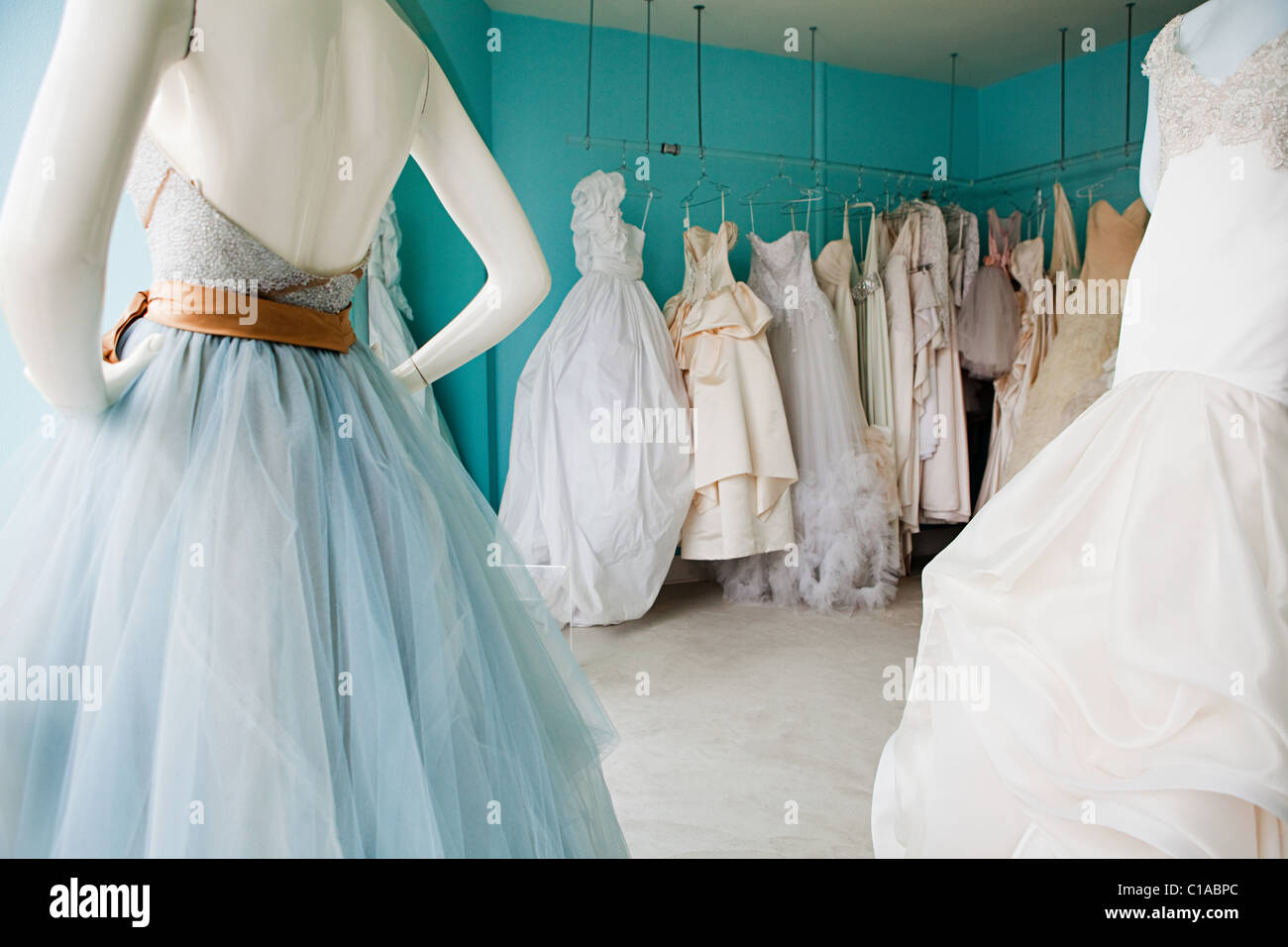 Selection of wedding dresses in boutique - Stock Image