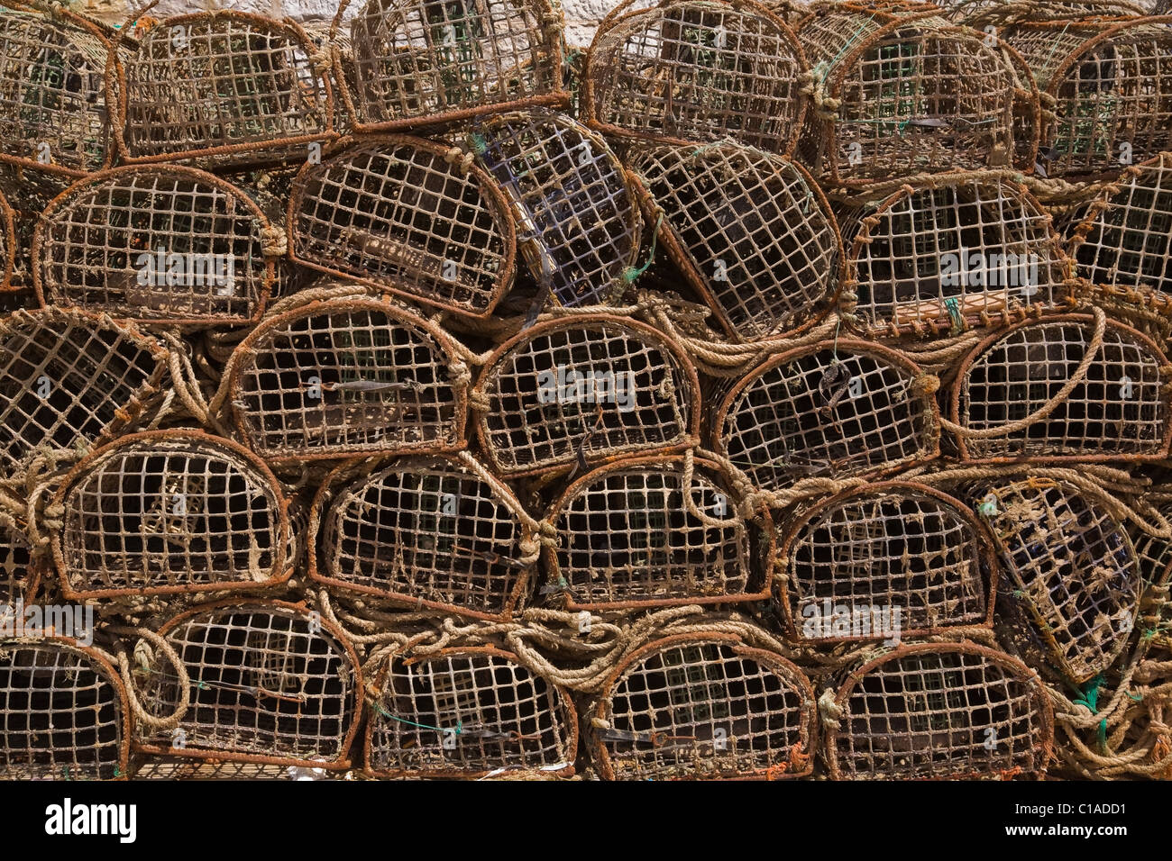 Stacks of commercial crab fishing baskets, Portugal - Stock Image