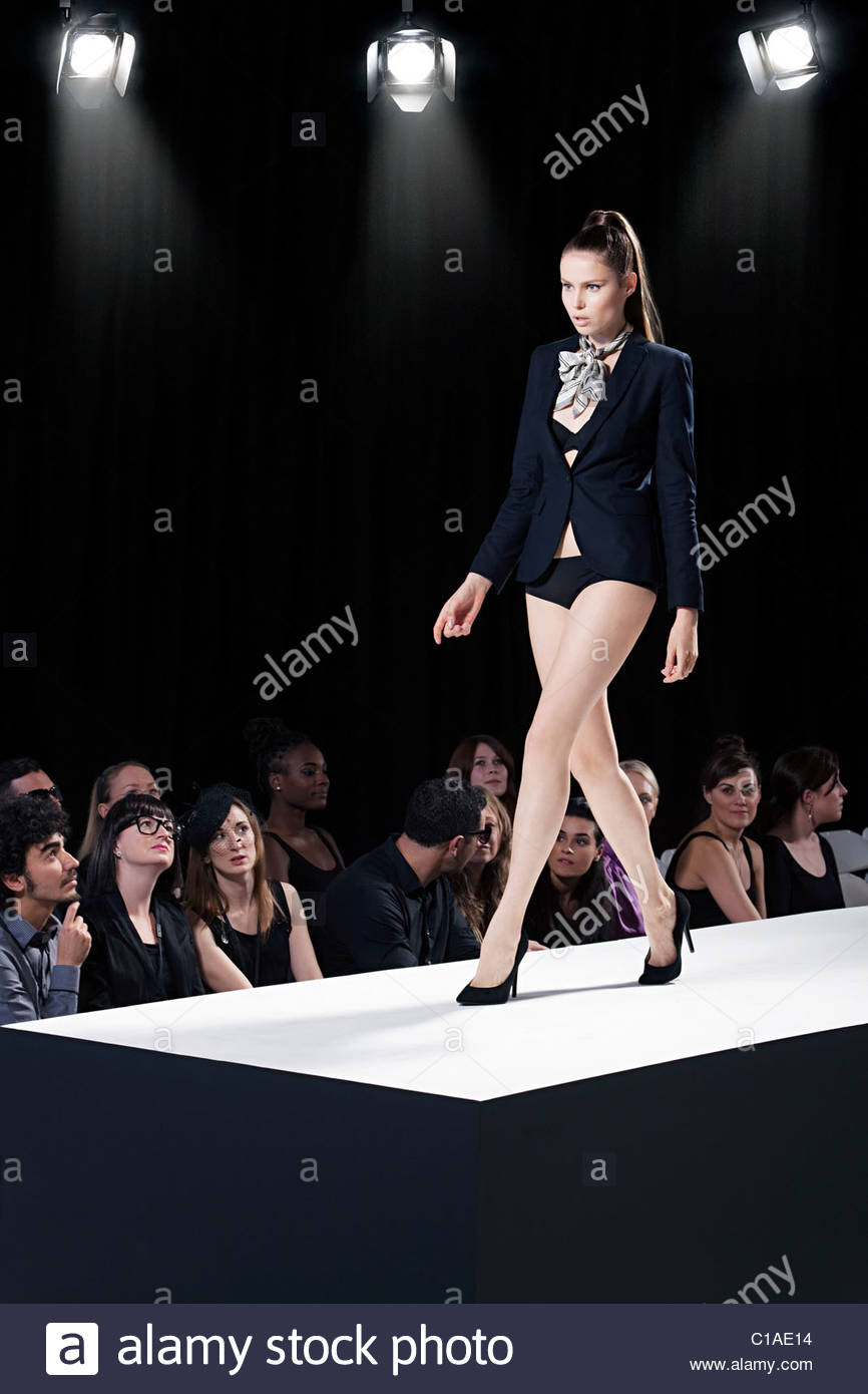 Model on catwalk at fashion show - Stock Image