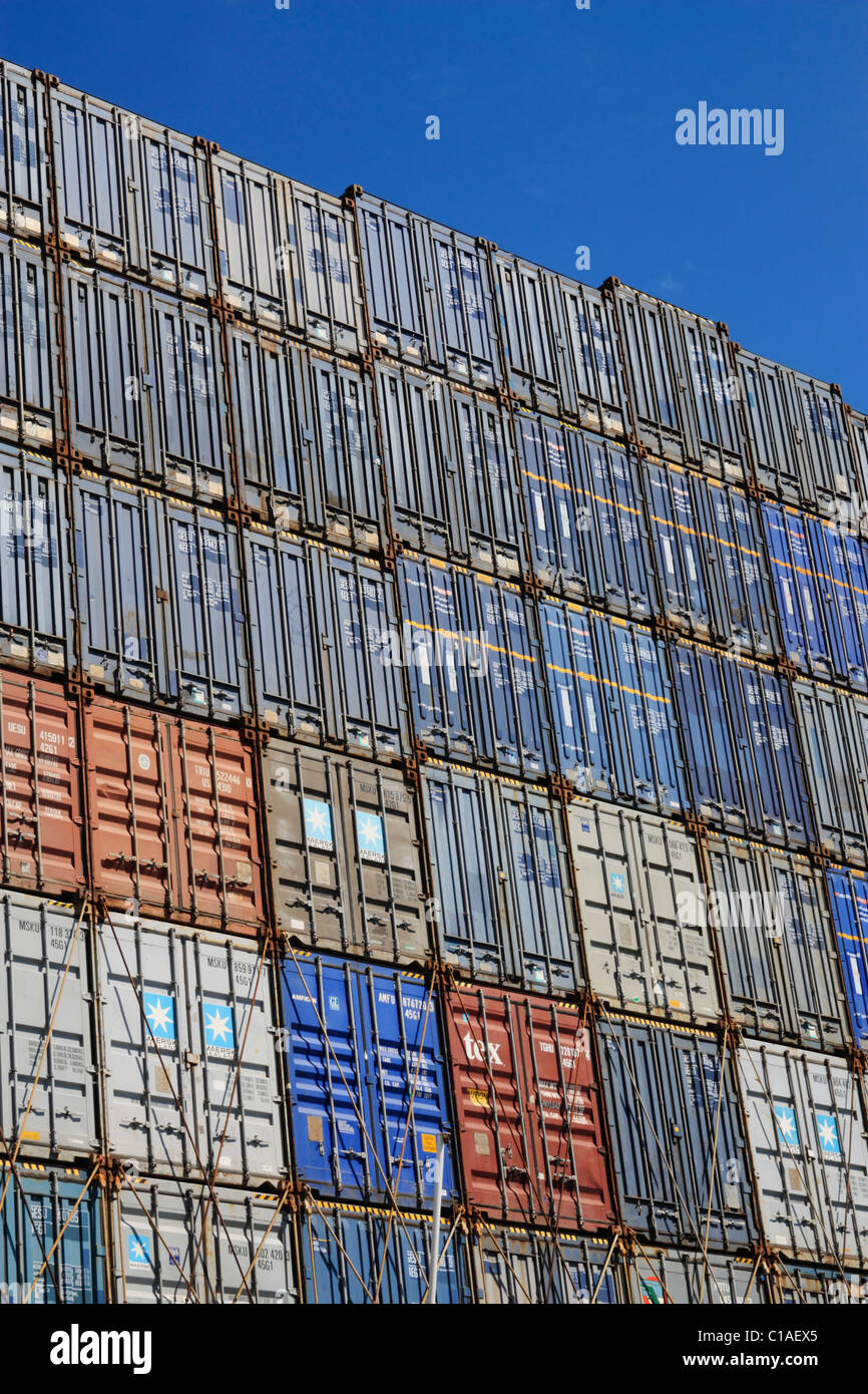 Shipping containers stacked on ship Stock Photo