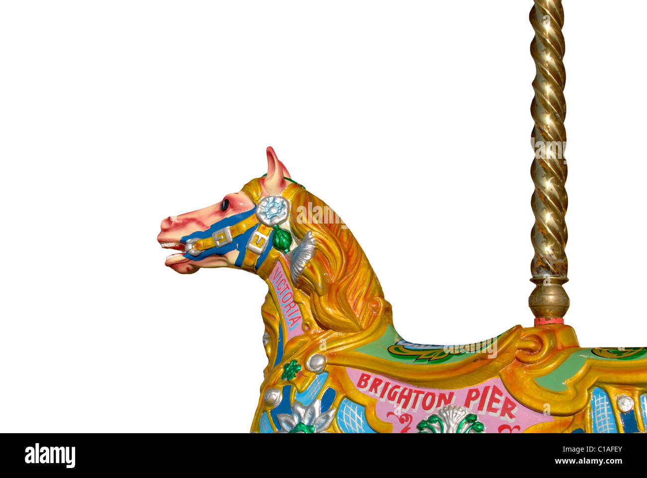Brightly coloured fairground horse on traditional roundabout. Brighton Pier. East Sussex. England. Cut out on white Stock Photo