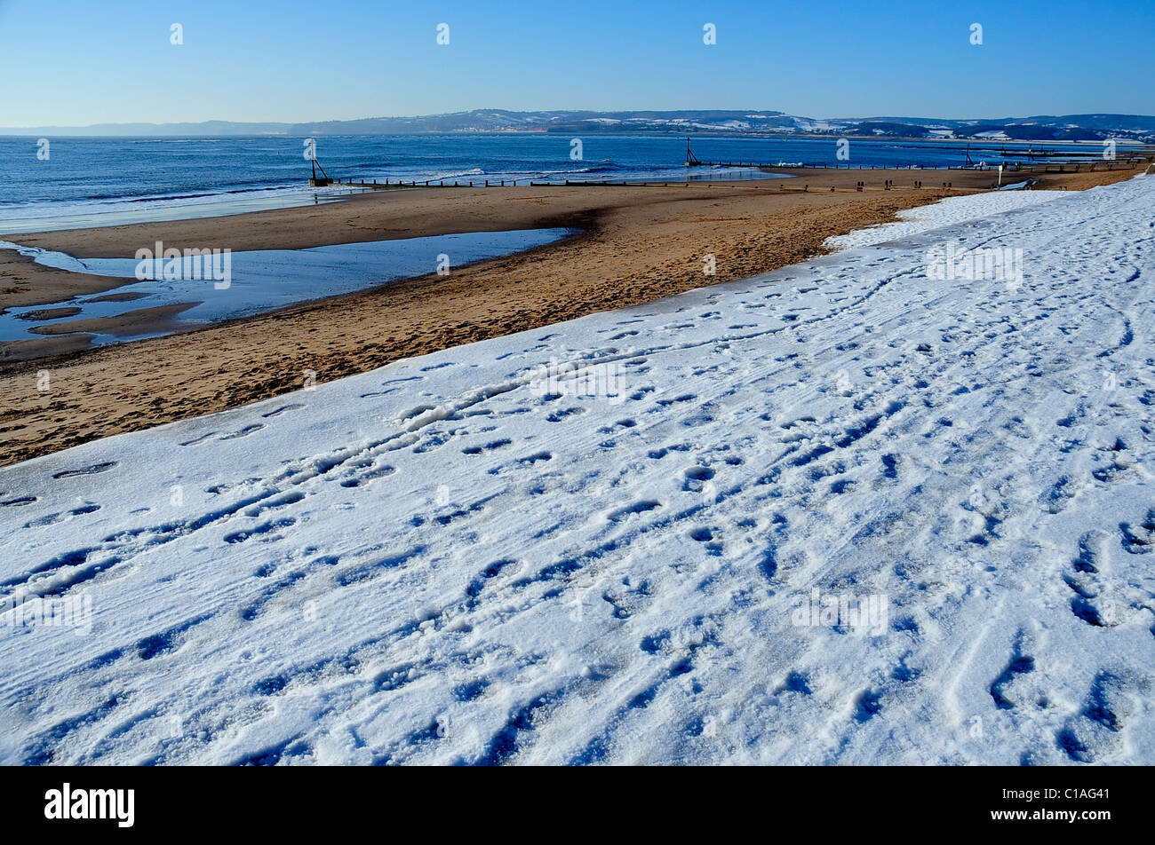 Exmouth beach (seafront) covered in some snow - Devon - Stock Image