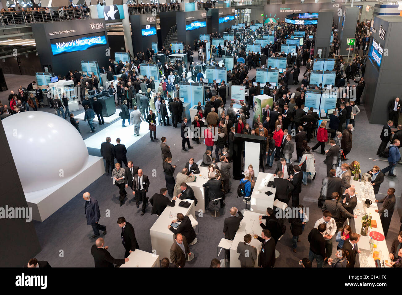 IBM exhibition area at CeBIT 2011 digital and electronics trade fair in Hannover March 2011 Germany - Stock Image