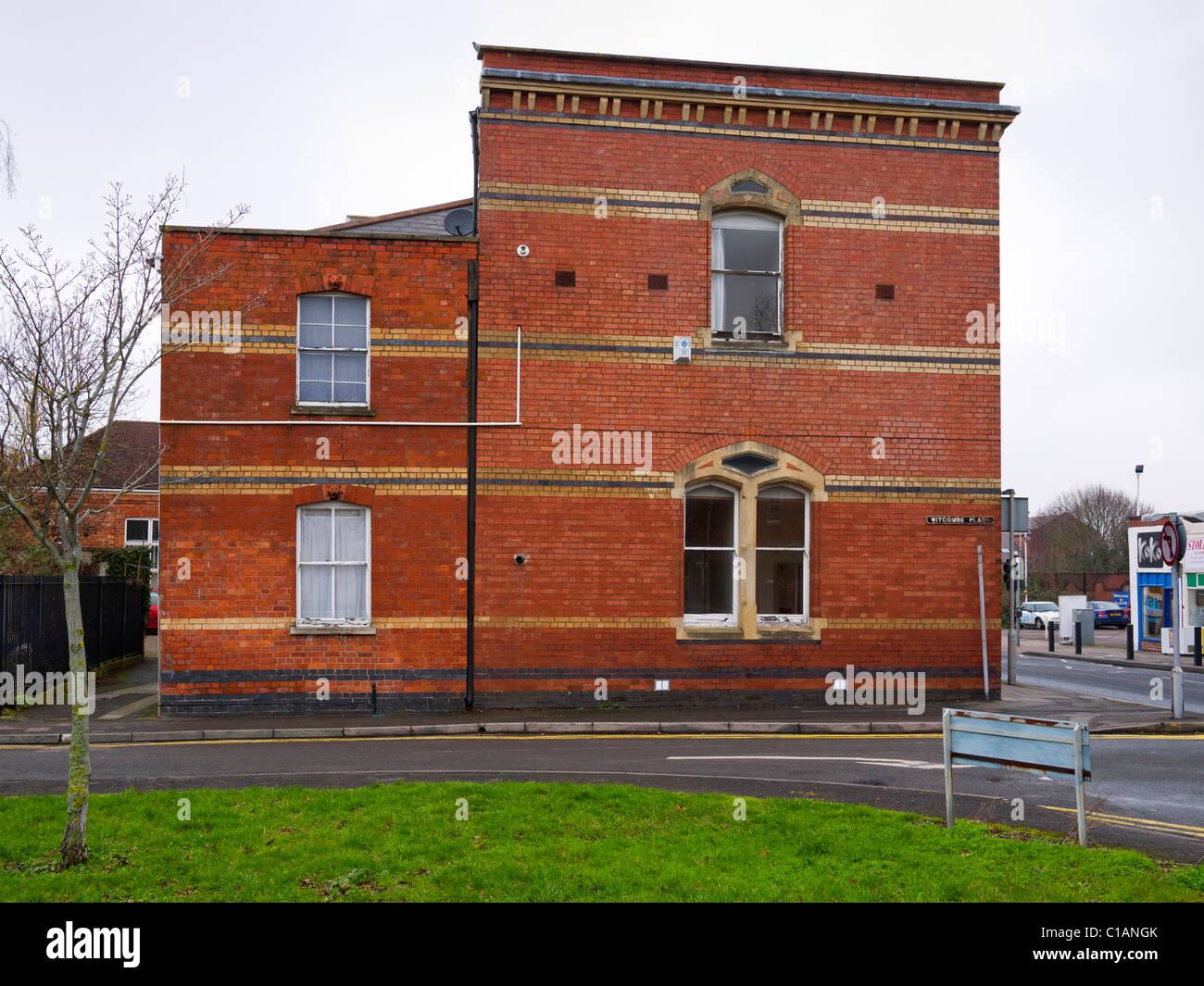 Side of a brick building, Mill House, in Albion Street, seen from Witcombe Place, Cheltenham, Gloucestershire, UK - Stock Image