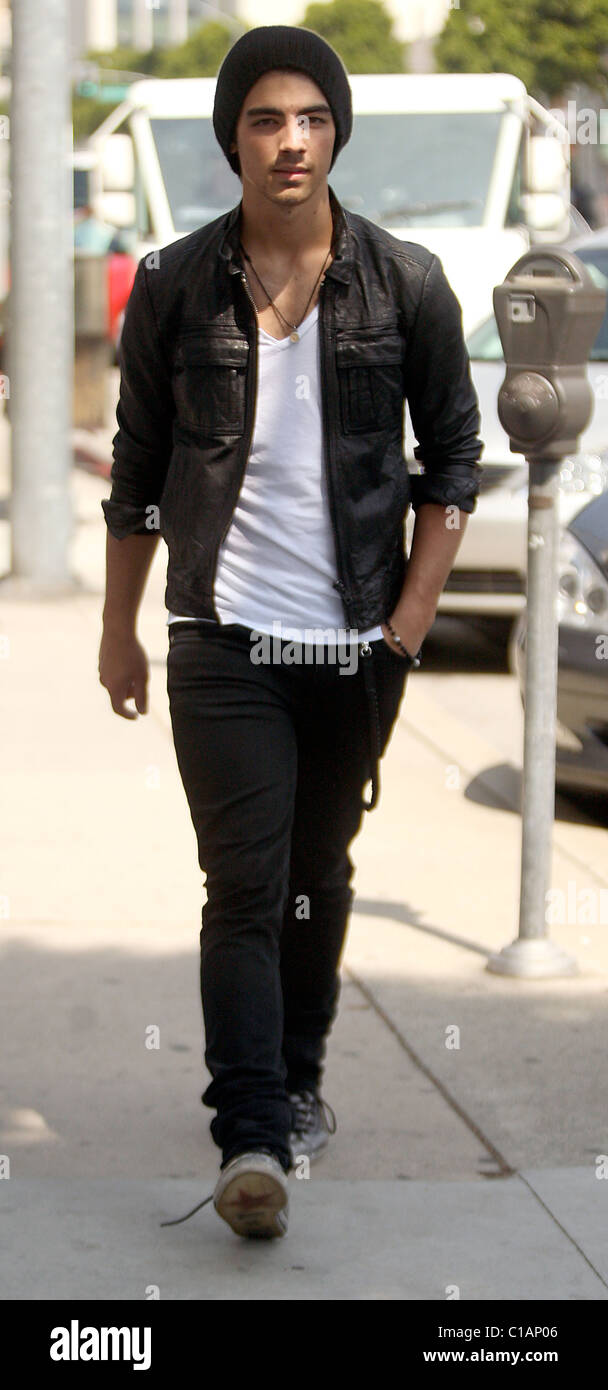 9c98090b870b Joe Jonas wearing Converse trainers