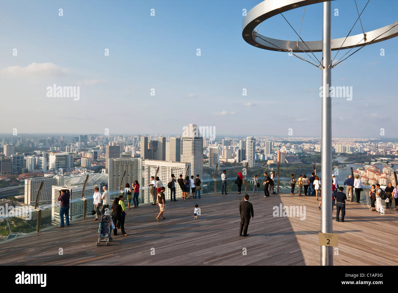 Visitors of Singapore skyline from observation deck of the Marina Bay Sands SkyPark.  Marina Bay, Singapore - Stock Image