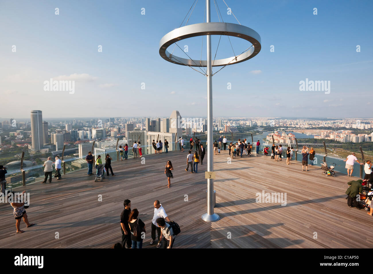 Visitors on the observation deck of the Marina Bay Sands SkyPark.  Marina Bay, Singapore - Stock Image