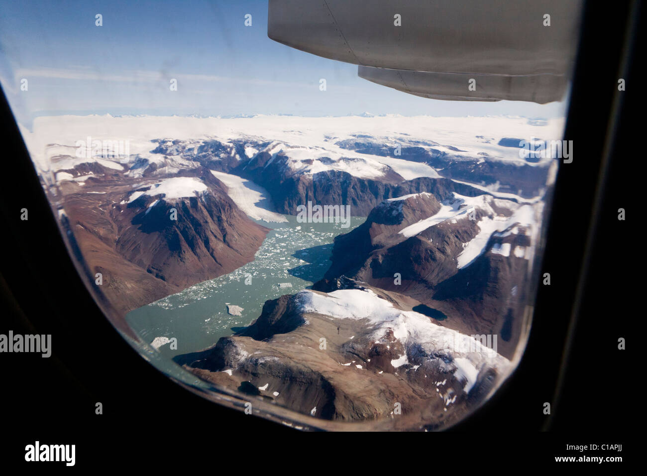 Plane flying towards Narsarsuaq airport, South Greenland Stock Photo