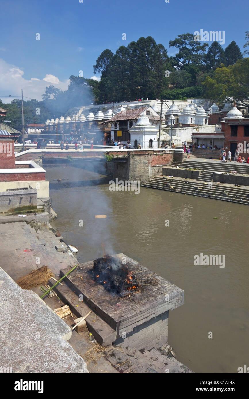 Pashupatinath Cremation site on the Bagmati river, Kathmandu, Nepal, Asia - Stock Image