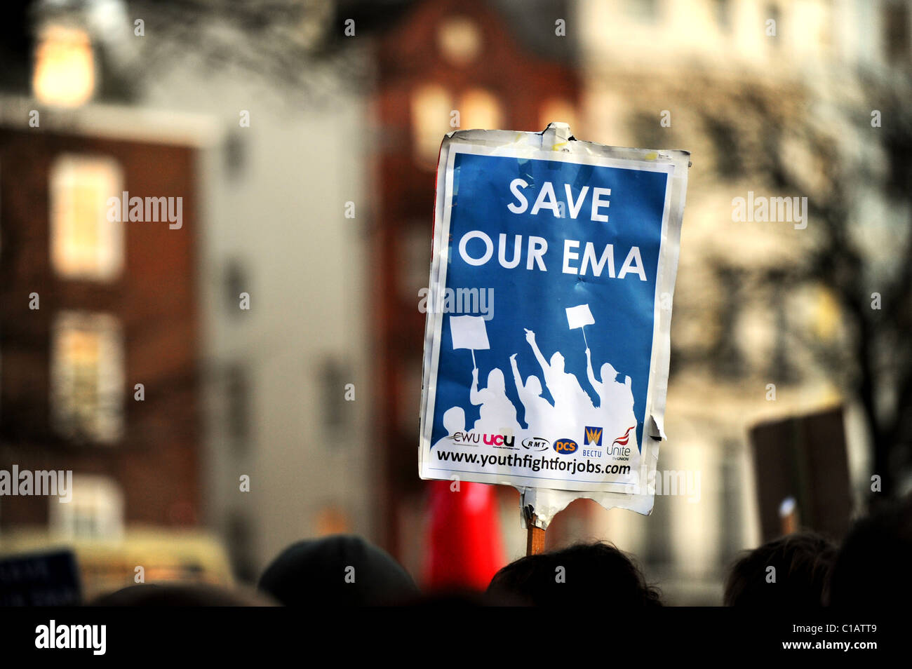 A student holds up a 'SAVE OUR EMA' placard during a protest held in Brighton - Stock Image